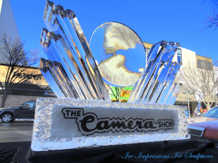 ice lens, ice impressions, ice impressions giant ice lens, 2012 winter, wowfest ice lens, camera shop ice lens, camera shop traverse city ice lens, ice sculpture, ice carving, michigan ice sculptures, ice sculpture northern michigan, traverse city ice sculpture, sculpture, ice shards, ice crystals, lens made out of ice.