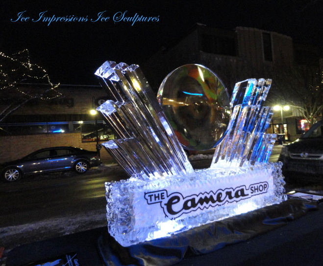 Ice Impressions Giant Ice Lens Ice Sculpture, ice lens, ice lens sculpture, winter, wowfest ice sculpture, traverse city ice sculpture, ice sculpture traverse city, northern michigan ice sculpture, michigan ice sculptures, winter festival ice sculptures, camera shop ice sculpture