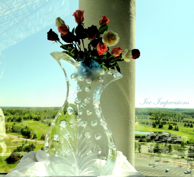 Mothers Day Rose Vase Ice Sculptures, Holiday Ice Sculptures, Ice Impressions Ice Sculpture Presentations.