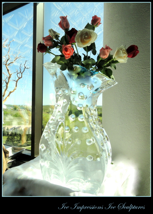 Vase Ice Sculpture, Ice Sculptures, Ice Carvings, Ice Carving, Ice Sculpture, Ice Impressions, Wedding Decor Ice Sculpture, Ice Sculptures for Weddings, Luxury Wedding Ice Sculptures, Ice Impressions, Northern Michigan Weddings,