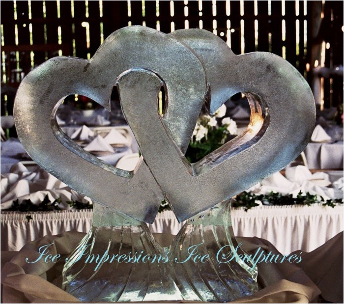 WEDDING-ICE-SCULPTURES, ICE-SCULPTURES-WEDDING, Wedding-Ice-Sculptures, ICE-IMPRESSIONS, By Ice Impressions, ice-impressions.com, wedding ice sculptures, intertwined hearts ice sculptures, ice sculptures, ice sculpture, Michigan ice sculptures, heart ice sculpture, Ice Impressions, Ice Impressions Ice Sculptures, Ice Sculptures, Ice Carvings, Ice Carving, Ice Sculpture, Wedding Decor, Wedding Centerpieces, Wedding Flowers, Luxury Weddings, Wedding Ice Sculptures, Ice Sculptures Weddings, Ice Carving Wedding, Chicago Weddings, Ice Carvings for Weddings, Wedding Ice Bar, Ice Bars for Weddings, Northern Michigan Weddings, Winery Weddings, Barn Weddings, Vineyard Weddings, Traverse City Weddings, Wine Country Weddings, Glen Arbor Weddings, Weddings Glen Arbor, Wedding Ice Sculptures, Ice Sculptures for Weddings.