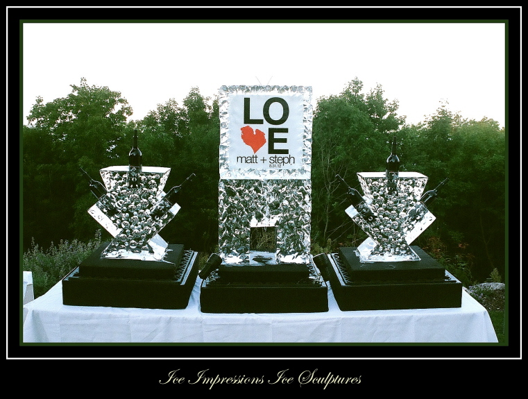 Com-Ice Luge, Ice Bottle Chillers, Custom Wedding Decor Ice Sculptures, wedding ice sculptures, wedding ice carving, ice carvings for weddings, ice sculpture northern michigan, Ice Sculpture, Ice Sculptures.