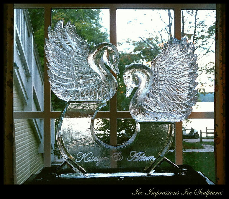 Com-Ice Sculpture, Com-Ice Sculptures, Com-Ice Carving, Com-Ice Carvings, Swan Ice Sculpture, Swan Ice Carving, Swan Ice Sculptures, Ice Sculpture, Northern Michigan Ice Sculptures, Wedding Decor Ice Sculptures, Wedding Decor Ice Sculpture, Michigan Ice Sculpture, Ice Impressions,