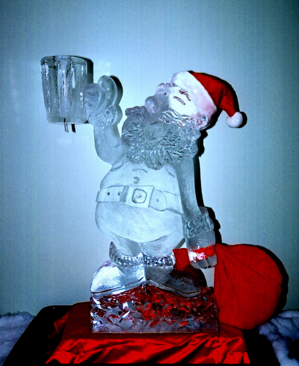 Santa, Santa with Milk, Santa Ice Sculpture, Santa Ice Carving, Ice Sculptures, Ice Carving, Ice Sculptures, Ice Impressions. Holiday Ice Sculptures, Holiday Ice carvings, Holiday Ice Carving, Holiday Ice Sculpture.